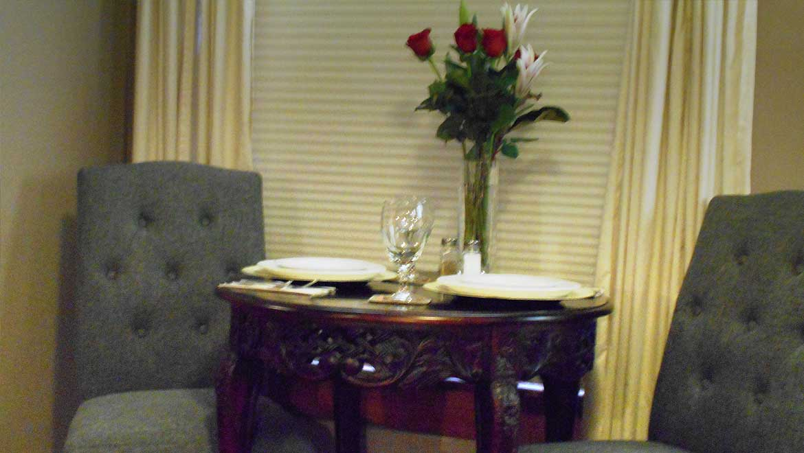 Table and chairs for dining in the Eureka Springs Bed and Breakfast suite, Summit Suite
